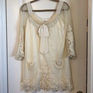 Baby doll style cream lace dress by Yoana Baraschi